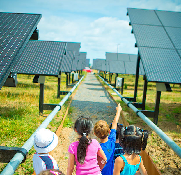 Children at UB solar array