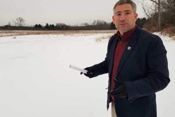 Man in front of snowy field
