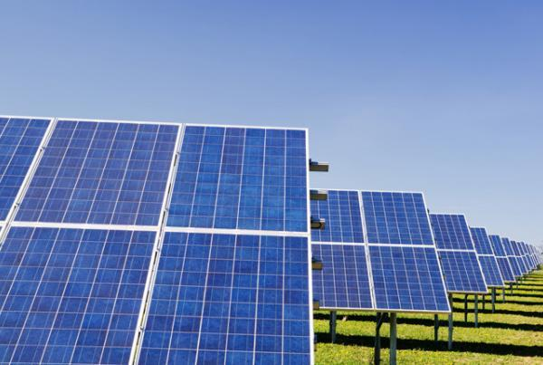 Row of solar panels with blue sky