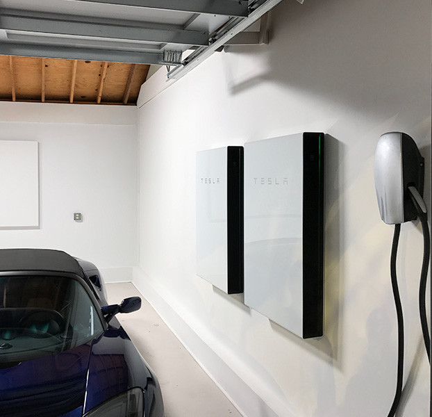 car in garage with Tesla system