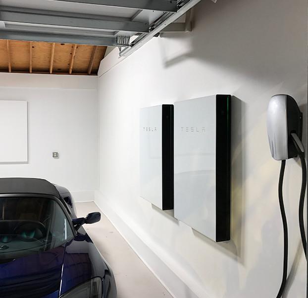 car in garage with Tesla system
