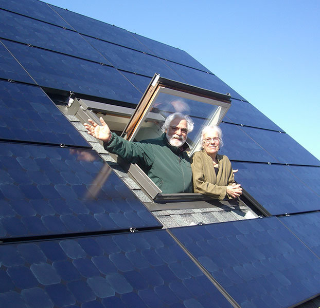 Man and woman with solar panels