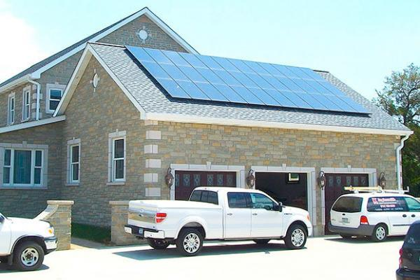 Cars parked in front of house with solar