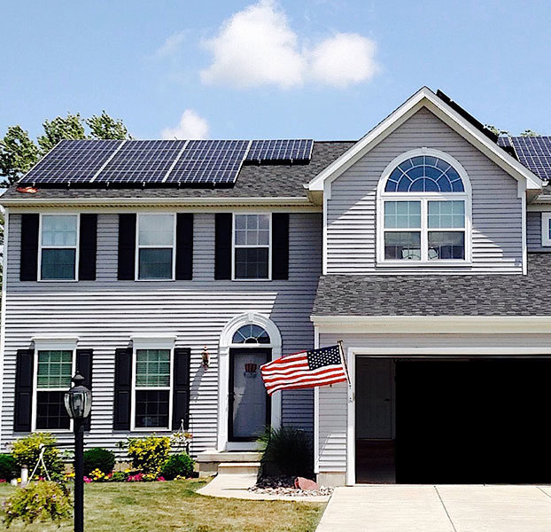 House with solar and American flag