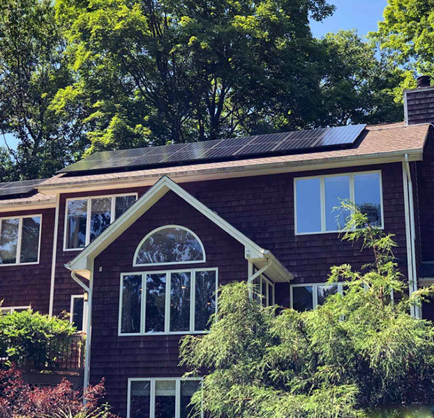 Brown house with solar panels