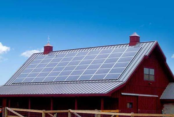 solar panels on red barn rooftop